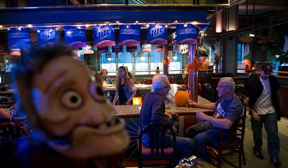 "Steve Gagliardi of Steubenville, Ohio, second from right, and Paul Grant, third from right, talk together at the bar at Froehlich's Classic Corner restaurant, Steubenville, Ohio, Friday, October 26, 2012. Of the election Gagliardi says, ""I'm a Romney supporter. I've been a banker all of my life and the debt of this nation will cripple us."" Once a productive steel town, Steubenville, Ohio's population has contracted faster than anywhere else in the country between 1980 and 2000 as their steel plants shut down. The area has seen a drop in unemployment in recent years due in part to the prospects of natural gas but the city still has a long way to go with unemployment figures higher then the the rest of the state and the country. (Andrew Harnik/The Washington Times)"