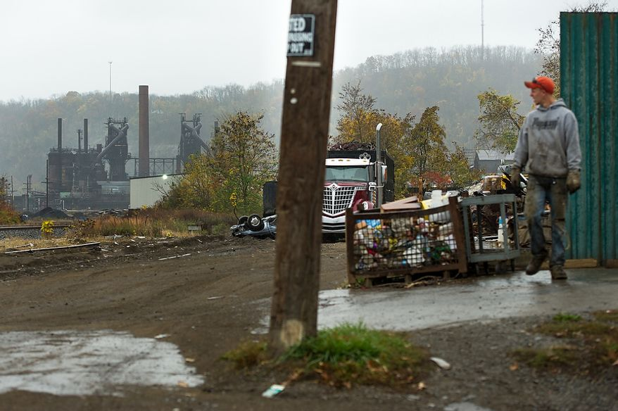A closed steel mill owned by dozens of companies over the years sits closed and rusting, far left, Steubenville, Ohio, Saturday, October 27, 2012. Once a productive steel town, Steubenville, Ohio's population has contracted faster than anywhere else in the country between 1980 and 2000 as their steel plants shut down. The area has seen a drop in unemployment in recent years due in part to the prospects of natural gas but the city still has a long way to go with unemployment figures higher then the the rest of the state and the country. (Andrew Harnik/The Washington Times)