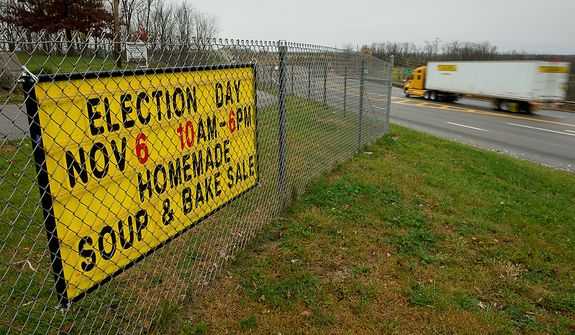 A small town election day reminder sign hangs in a suburb outside downtown Steubenville, Ohio, Saturday, October 27, 2012. Once a productive steel town, Steubenville, Ohio's population has contracted faster than anywhere else in the country between 1980 and 2000 as their steel plants shut down. The area has seen a drop in unemployment in recent years due in part to the prospects of natural gas but the city still has a long way to go with unemployment figures higher then the the rest of the state and the country. (Andrew Harnik/The Washington Times)