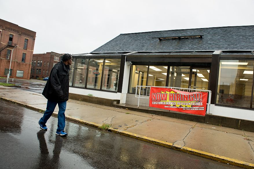 J.J. Alexander of Steubenville, Ohio, walks past an old Hardy's fast food building which will be used as a new call center in downtown, Steubenville, Ohio, Saturday, October 27, 2012. Alexander is a dishwasher for the local Smokey Bones and Robinson Restaurant and has been able to find regular work but says he has friends and family members who are struggling. Once a productive steel town, Steubenville, Ohio's population has contracted faster than anywhere else in the country between 1980 and 2000 as their steel plants shut down. The area has seen a drop in unemployment in recent years due in part to the prospects of natural gas but the city still has a long way to go with unemployment figures higher then the the rest of the state and the country. (Andrew Harnik/The Washington Times)