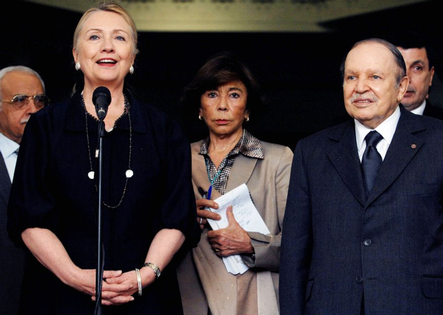 Algerian President Abdelaziz Bouteflika, right, and U.S. Secretary of State Hillary Rodham Clinton, front left, speak during a news conference following their meeting in Algiers, Monday, Oct .29, 2012. (AP Photo/Sidali Djarboub)