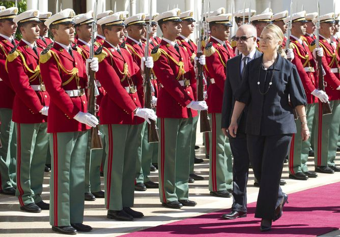 Algerian Foreign Minister Mourad Medelci, second right, walks alongside US Secretary of State Hillary Rodham Clinton, as she arrives for meetings, at the Mouradia Palace, in Algiers, Algeria, Monday, Oct. 29, 2012. U.S. Secretary of State Hillary Rodham Clinton sought Algeria's assistance on Monday for any future military intervention in Mali, pressing the North African nation to provide intelligence, if not boots on the ground to help rout the al-Qaida-linked militants across its southern border. Clinton, on the first stop of a five-day trip overseas, met with Algerian President Abdelaziz Bouteflika as the United States and its allies ramped up preparations to fight northern Mali's breakaway Islamist republic. (AP Photo, Saul Loeb, Pool)