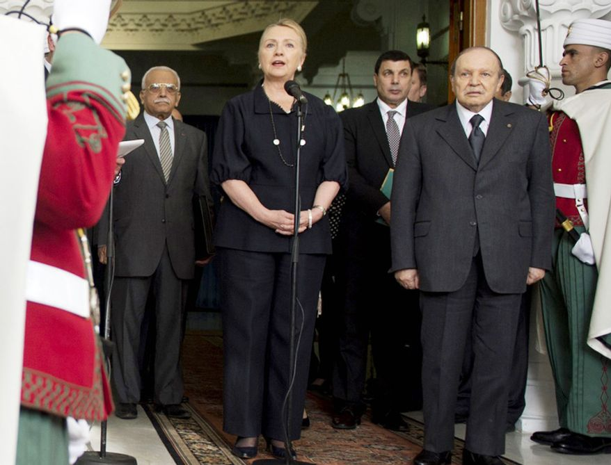 Algerian President Abdelaziz Bouteflika, right, and U.S. Secretary of State Hillary Rodham Clinton, front left, speak during a news conference following their meeting in Algiers, Monday, Oct. 29, 2012.  (AP Photo/SAUL LOEB)