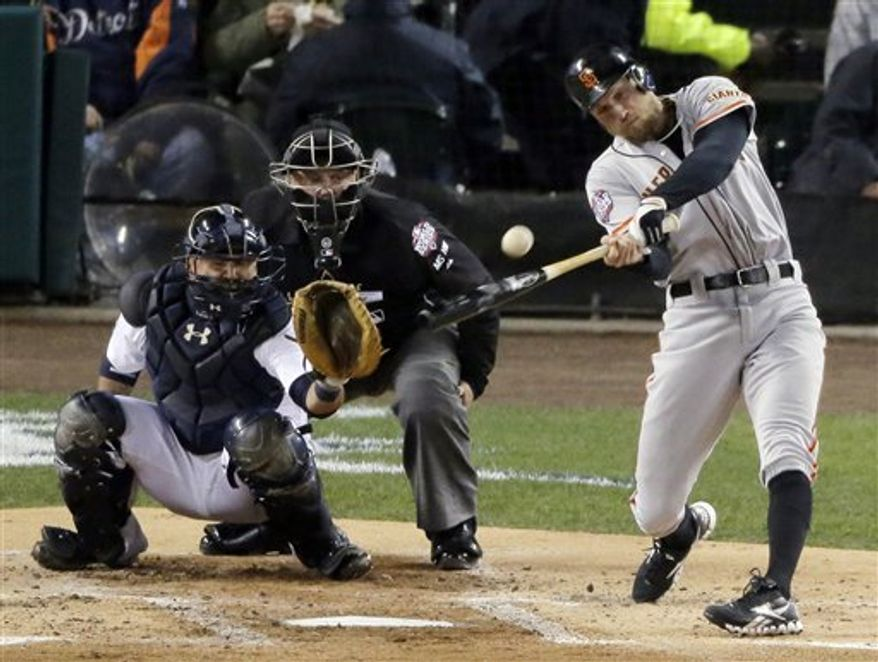 San Francisco Giants right fielder Hunter Pence hits a ground rule double during the second inning of Game 4 of baseball's World Series against the Detroit Tigers Sunday, Oct. 28, 2012, in Detroit. (AP Photo/Charlie Riedel)