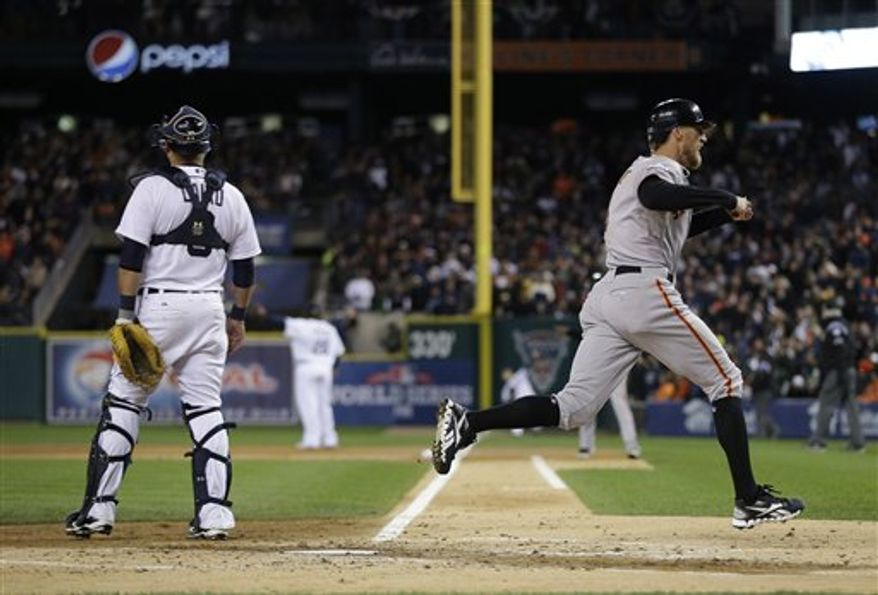 San Francisco Giants' Hunter Pence, right, scores on a hit by Brandon Belt during the second inning of Game 4 of baseball's World Series against the Detroit Tigers Sunday, Oct. 28, 2012, in Detroit. (AP Photo/Matt Slocum)