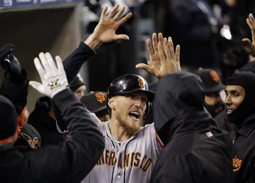 San Francisco Giants' Hunter Pence reacts in the dugout after scoring a run during the second inning of Game 4 of baseball's World Series against the Detroit Tigers Sunday, Oct. 28, 2012, in Detroit. (AP Photo/David J. Phillip)
