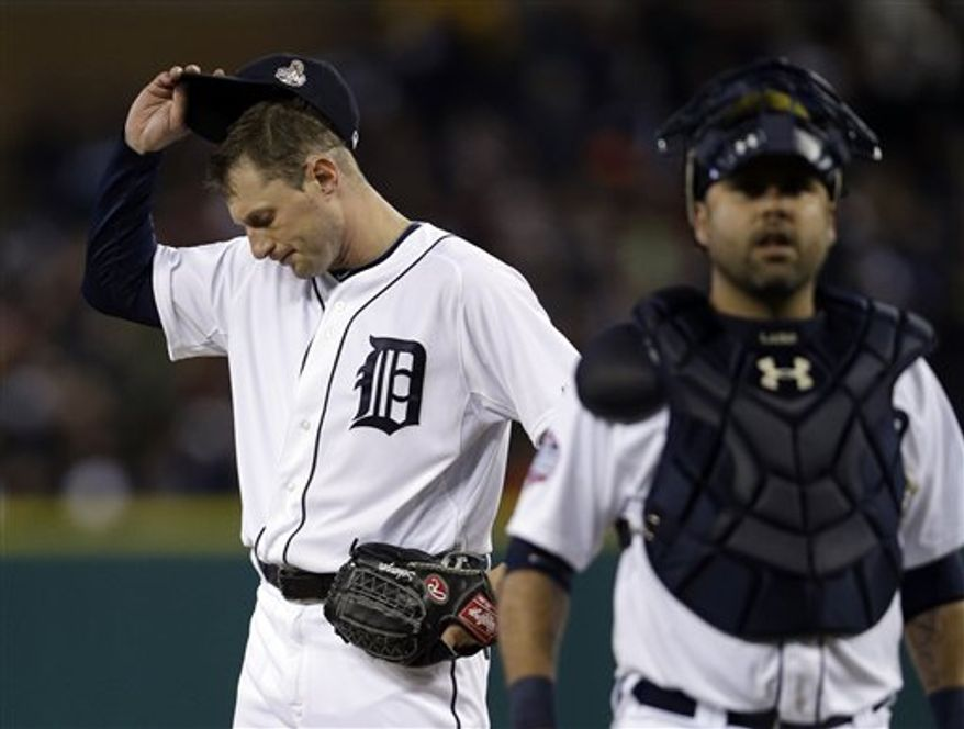 Detroit Tigers starting pitcher Max Scherzer reacts after giving up a hit to San Francisco Giants' Angel Pagan during the third inning of Game 4 of baseball's World Series Sunday, Oct. 28, 2012, in Detroit. (AP Photo/Matt Slocum)