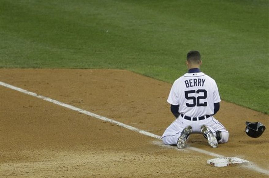 Detroit Tigers' Quintin Berry reacts after being thrown out by San Francisco Giants shortstop Brandon Crawford at first during the fifth inning of Game 4 of baseball's World Series Sunday, Oct. 28, 2012, in Detroit. (AP Photo/Patrick Semansky)