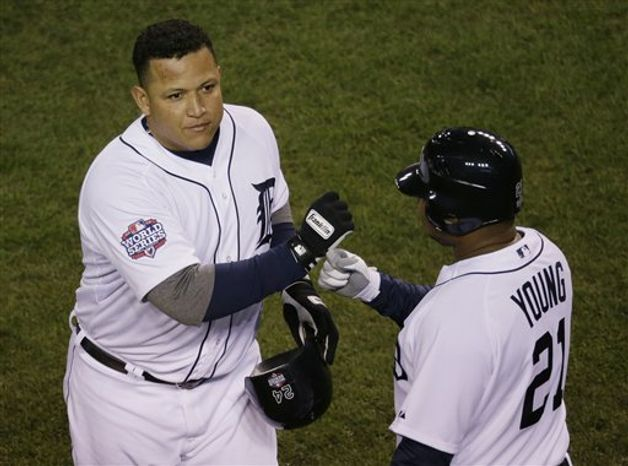 Detroit Tigers' Miguel Cabrera, left, celebrates with Delmon Young after hitting a two-run home run during the third inning of Game 4 of baseball's World Series against the San Francisco Giants Sunday, Oct. 28, 2012, in Detroit. (AP Photo/Carlos Osorio)