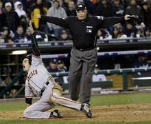 San Francisco Giants' Ryan Theriot reacts after scoring from second on a hit by Marco Scutaro during the 10th inning of Game 4 of baseball's World Series against the Detroit Tigers Sunday, Oct. 28, 2012, in Detroit. (AP Photo/David J. Phillip)