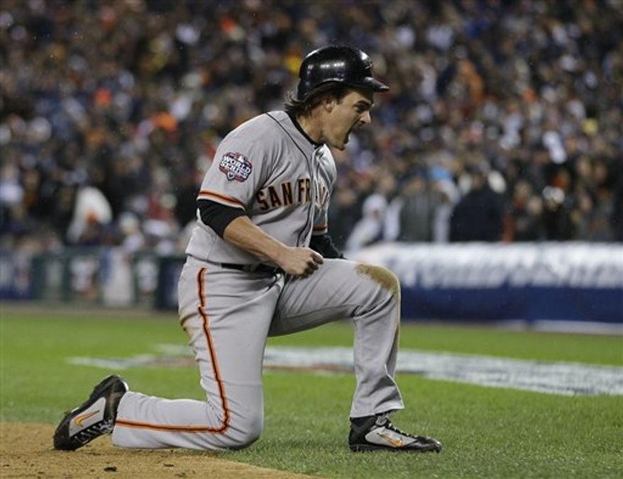 San Francisco Giants' Ryan Theriot reacts after scoring on an RBI single by Marco Scutaro during the10th inning of Game 4 of baseball's World Series against the Detroit Tigers Sunday, Oct. 28, 2012, in Detroit. (AP Photo/Matt Slocum)