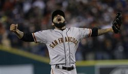 San Francisco Giants' Sergio Romo reacts after striking out Detroit Tigers' Miguel Cabrera in the 10th inning of Game 4 of baseball's World Series Sunday, Oct. 28, 2012, in Detroit. The Giants won the game 4-3 to win the World Series. (AP Photo/Matt Slocum)