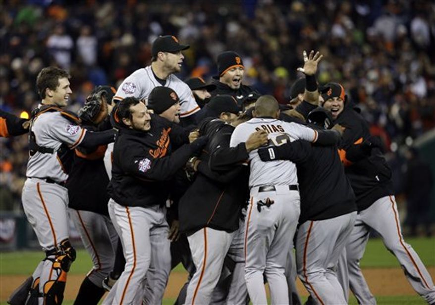 San Francisco Giants celebrate after winning Game 4 of baseball's World Series against the Detroit Tigers Sunday, Oct. 28, 2012, in Detroit. The Giants won 4-3 to win the series. (AP Photo/David J. Phillip)