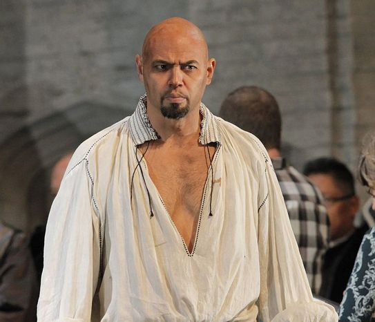 """Keith Miller plays Lord Rochefort in Donizetti's """"Anna Bolena,"""" at the Metropolitan Opera in New York. The former University of Colorado fullback has reinvented himself, going from the gridiron to the stage and will appear in Verdi's """"Un Ballo in Maschera,"""" at the Metropolitan Opera. Performances begin Thursday, Nov. 8, 2012. (AP Photo/Metropolitan Opera, Ken Howard)"""