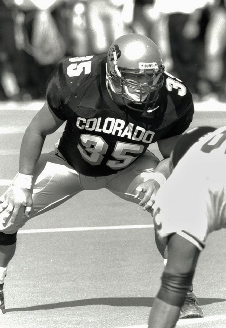 """Keith Miller waits for the ball snap as a fullback for the school's NCAA college football team at the University of Colorado. Miller has reinvented himself, going from the gridiron to the stage and will appear in Verdi's """"Un Ballo in Maschera,"""" at the Metropolitan Opera in New York. (AP Photo/University of Colorado)"""