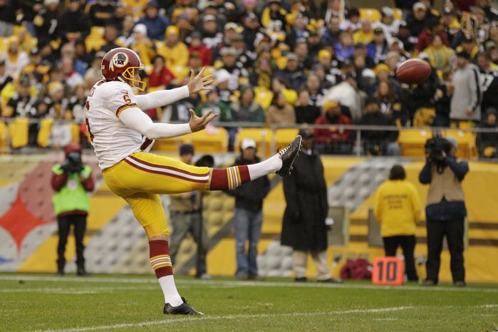 Washington Redskins punter Sav Rocca (6) punts during the first quarter of an  NFL football game against the Pittsburgh Steelers in Pittsburgh, Sunday, Oct. 28, 2012. The
