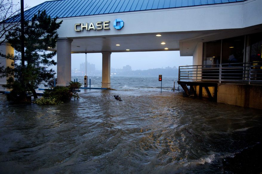 Rising water from the Hudson River overtakes a bank drive-through in Edgewater, N.J., Monday, Oct. 29, 2012, as Hurricane Sandy lashed the East Coast. (AP Photo/Craig Ruttle)