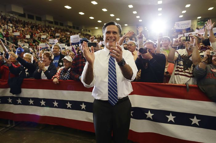 Republican presidential candidate Mitt Romney applauds as he watches the Oak Ridge Boys perform as he campaigns at the Veterans Memorial Coliseum at the Marion County Fairgrounds in Marion, Ohio, on Sunday, Oct. 28, 2012. (AP Photo/Charles Dharapak)
