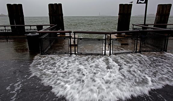 Waves wash over the seawall near high tide at Battery Park in New York on Monday, Oct. 29, 2012, as Hurricane Sandy approaches the East Coast. Hurricane Sandy continued on its path Monday, forcing the shutdown of mass transit, schools and financial markets; sending coastal residents fleeing; and threatening a dangerous mix of high winds and soaking rain. (AP Photo/Craig Ruttle)