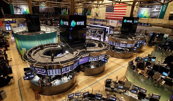 The floor of the New York Stock Exchange is empty of traders,on Monday, Oct. 29, 2012, in New York. All major U.S. stock and options exchanges will remain closed Monday with Hurricane Sandy nearing landfall on the East Coast. Trading has rarely stopped for weather. A blizzard led to a late start and an early close on Jan. 8, 1996, according to the exchange's parent company, NYSE Euronext. The NYSE also shut down on Sept. 27, 1985, for Hurricane Gloria. (AP Photo/Richard Drew)