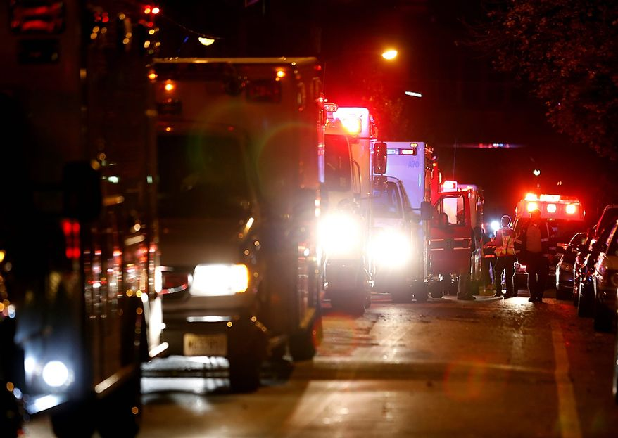 Ambulances line up near the Hoboken University Medical Center, where patients were evacuated in anticipation of Hurricane Sandy, on Sunday, Oct. 28, 2012, in Hoboken, N.J. Tens of thousands of people were ordered to evacuate coastal areas as big cities and small towns across the Northeast braced for the onslaught of a superstorm threatening some 60 million people along the most heavily populated corridor in the nation. (AP Photo/Julio Cortez)