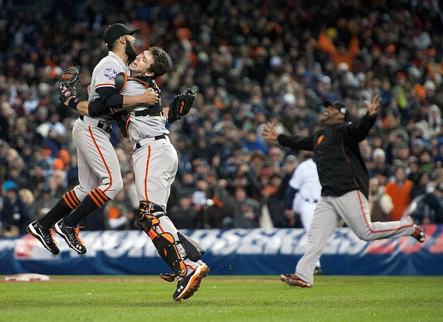San Francisco Giant's catcher Buster Posey and pitcher Sergio Romo celebrate defeating the Detroit Tigers in Game 4 of baseball's World Series on Sunday, Oct. 28, 2012, in Detroit. The Giants won the World Series 4-0. (AP Photo/The Sacramento B