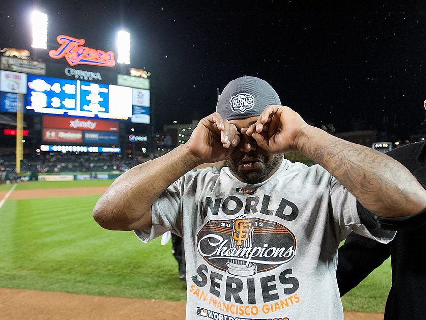 San Francisco Giants third baseman Pablo Sandoval (48), MVP of the World Series, wipes his face after defeating the Detroit Tigers to sweep the series during Game 4 of baseball's World Series on Sunday, Oct. 28, 2012, in Detroit. The Giants won the World Series 4-0. (AP Photo/The Sacramento Bee, Paul Kitagaki Jr.)  MAGS OUT; LOCAL TV OUT (KCRA3, KXTV10, KOVR13, KUVS19, KMAZ31, KTXL40); MANDATORY CREDIT