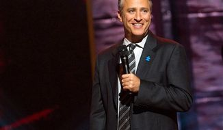 "** FILE ** Comedian and TV host Jon Stewart appears onstage at Comedy Central's ""Night of Too Many Stars"" event at the Beacon Theatre in New York on Oct. 2, 2010. (AP Photo/Charles Sykes)"