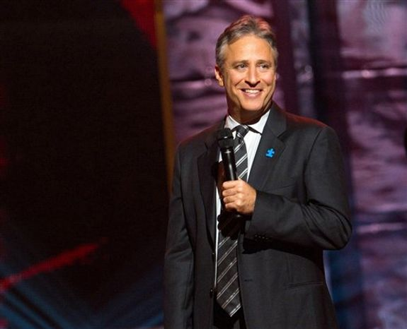 """** FILE ** Comedian and TV host Jon Stewart appears onstage at Comedy Central's """"Night of Too Many Stars"""" event at the Beacon Theatre in New York on Oct. 2, 2010. (AP Photo/Charles Sykes)"""