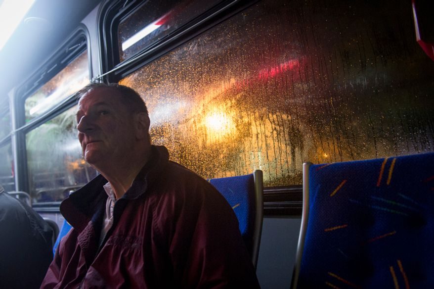 Lee Strom waits on a city bus to be taken to a shelter at the Lee District RECenter in Franconia, Va., during a mandatory evacuation order in the Huntington neighborhood of Alexandria, Va., Monday, Oct. 29, 2012, while high winds and heavy rain from Hurricane Sandy pound the Atlantic coast. Mr. Strom's home is on Arlington Terrace. (Rod Lamkey Jr./The Washington Times)