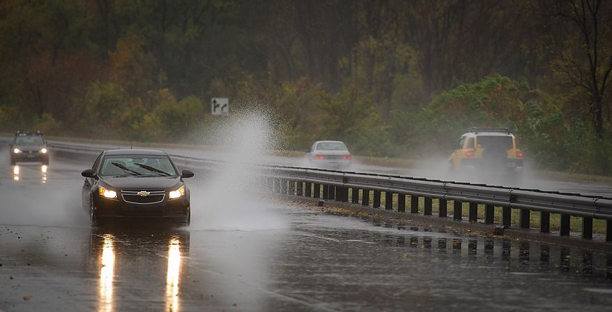 A car hydroplanes in standing water northbound on the George Washington Memorial Parkway neat Gravelly Point in Alexandria, Va., Monday, Oct. 29, 2012 while Hurricane Sandy makes it's way north along the Atlantic coast. (Rod Lamkey Jr./The Washington Times)