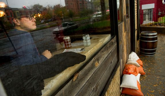 Luis Saucedo who has recently moved to Washington, D.C. walked a few blocks over to Boundary Stone to have a beer before everything shut down along Rhode Island Avenue in the Bloomingdale neighborhood of Northwest, Washington, D.C., Monday, October 29, 2012. Hurricane Sandy begins to affect the Washington, D.C. region. (Andrew Harnik/The Washington Times)