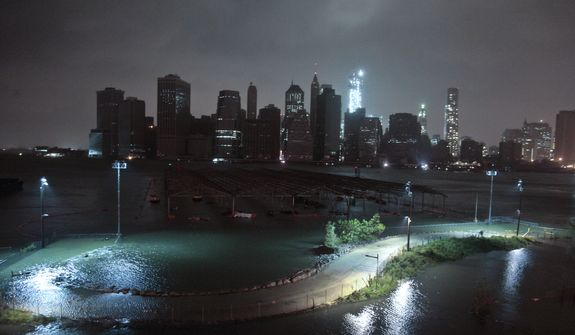 Lower Manhattan goes dark during hurricane Sandy, on Monday, Oct. 29, 2012, as seen from Brooklyn, N.Y. Sandy continued on its path Monday, as the storm forced the shutdown of mass transit, schools and financial markets, sending coastal residents fleeing, and threatening a dangerous mix of high winds and soaking rain. (AP Photo/Bebeto Matthews)