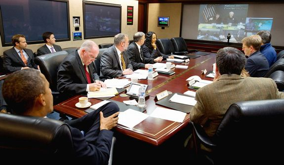 President Barack Obama receiving an update on the ongoing response to Hurricane Sandy, in the Situation Room of the White House in Washington, Monday, Oct. 29 2012.  (AP Photo/Pete Souza, White House)