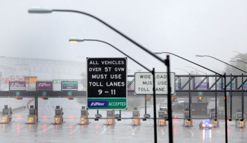 Toll lanes are closed at Maryland's Chesapeake Bay Bridge, which is closed because of winds from Hurricane Sandy, Monday, Oct. 29, 2012. Hurricane Sandy continued on its path Monday, as the storm forced the shutdown of mass transit, schools and financial markets, sending coastal residents fleeing, and threatening a dangerous mix of high winds and soaking rain. (AP Photo/Steve Ruark)