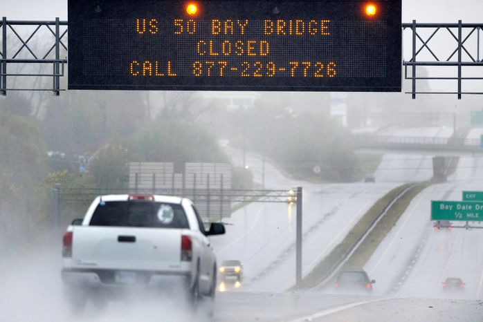 A sign informs motorists along U.S. Route 50 that Maryland's Chesapeake Bay Bridge, which connects the state's eastern and western shores, is closed because of winds from Hurricane Sandy Monday, Oct. 29, 2012.  (AP Photo/Steve Ruark)