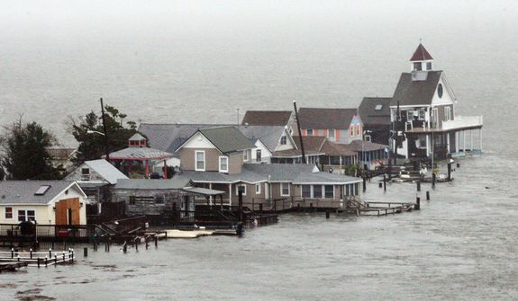 A row of houses stands in floodwaters at Grassy Sound in North Wildwood, N.J., as Hurricane Sandy pounds the East Coast Monday Oct. 29, 2012.  (AP Photo/The Press of Atlantic City, Dale Gerhard)
