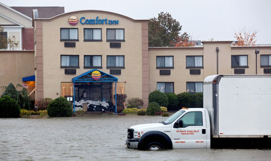 Water from the Hudson River surrounds a hotel in Edgewater, N.J., Monday, Oct. 29, 2012 as Hurricane Sandy lashes the East Coast. (AP Photo/Craig Ruttle)