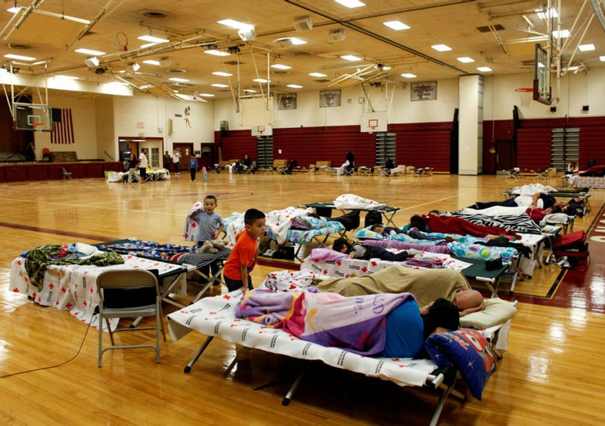 A few dozen people take refuge from Hurricane Sandy at a Red Cross shelter, Monday, Oct. 29, 2012, in Deer Park, N.Y. (AP Photo/Jason DeCrow)