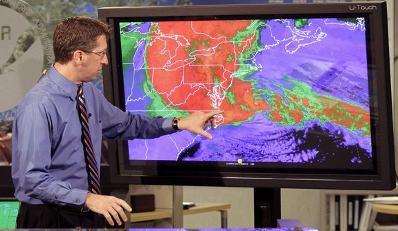 Rick Knabb, director of the National Hurricane Center, points to the satellite image of hurricane Sandy at the National Hurricane Center in Miami, Monday, Oct. 29, 2012. (AP Photo/Alan Diaz)