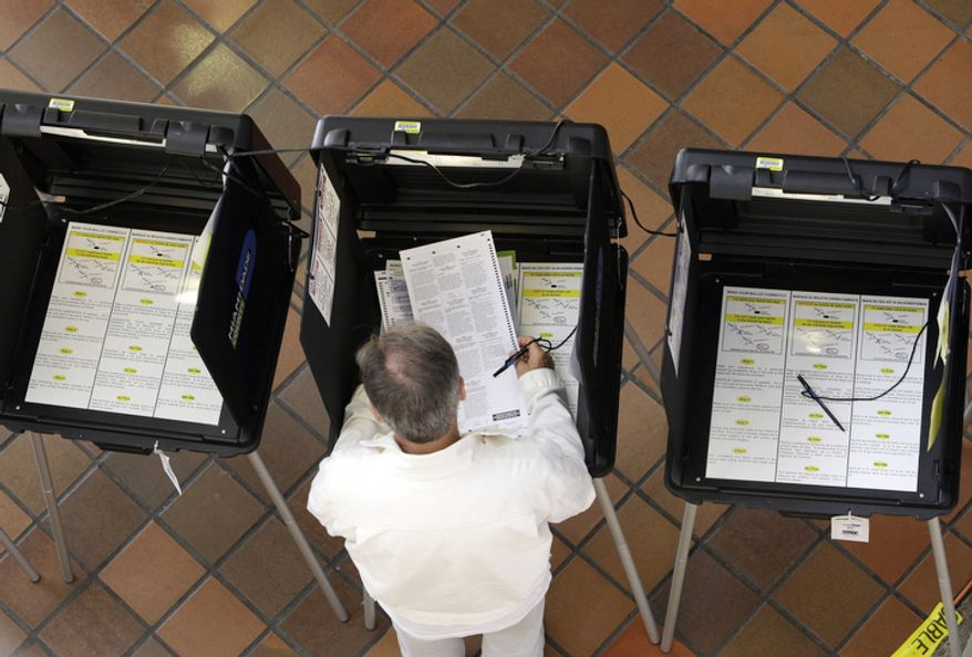 A man votes during early voting for the presidential election, Monday, Oct. 29, 2012, in Miami, Florida. About 1.9 million Floridians have already cast ballots eight days before Election Day, Nov 6. (AP Photo/Lynne Sladky)