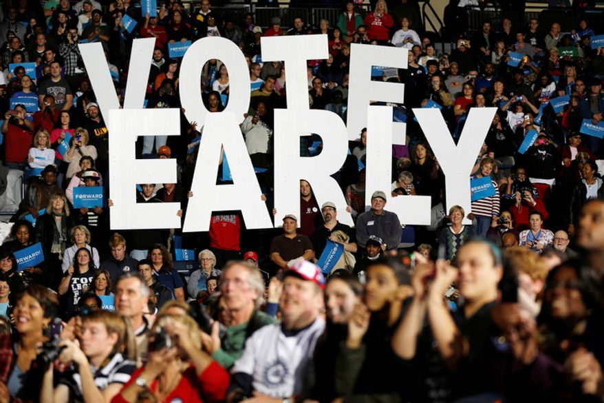 """A""""Vote Early""""  sign in displayed as former President Bill Clinton speaks at a President Barack Obama campaign rally, Monday, Oct. 29, 2012, in Youngstown, Ohio. (AP Photo/Matt Rourke)"""