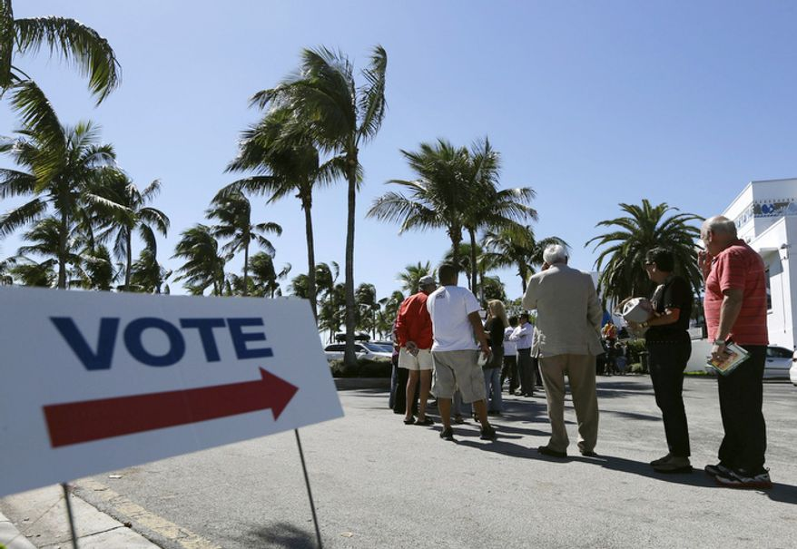 People stand in line to vote in the presidential election, Monday, Oct. 29, 2012, in Miami, Florida. (AP Photo/Lynne Sladky)