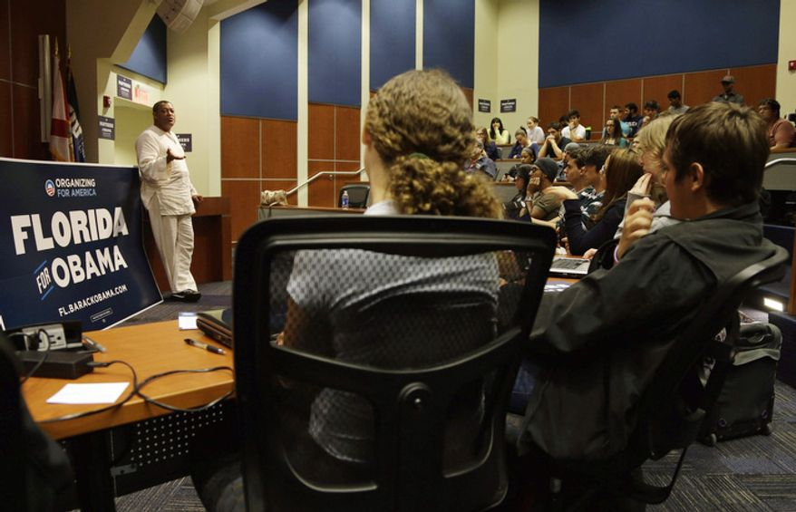 Actor Lawrence Fishburne, left, speaks to students at Florida International University in support of President Barack Obama, and to encourage supporters to take advantage of early voting, Monday, Oct. 29, 2012, in Miami. The presidential election is Nov 6. (AP Photo/Lynne Sladky)