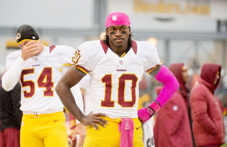 Washington Redskins quarterback Robert Griffin III (10) stands on the sideline towards the end of the game as the Washington Redskins lose to the Pittsburgh Steelers 27-12 at Heinz Field, Pittsburgh, Pa., Sunday, October 28, 2012. (Andrew Harnik/The Washington Times)