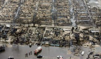 Burned homes in the Breezy Point section of the Queens borough New York show the destruction Tuesday. The beachfront neighborhood was told to evacuate before superstorm Sandy. It was wracked with fire and flooding at the same time. (Associated Press)