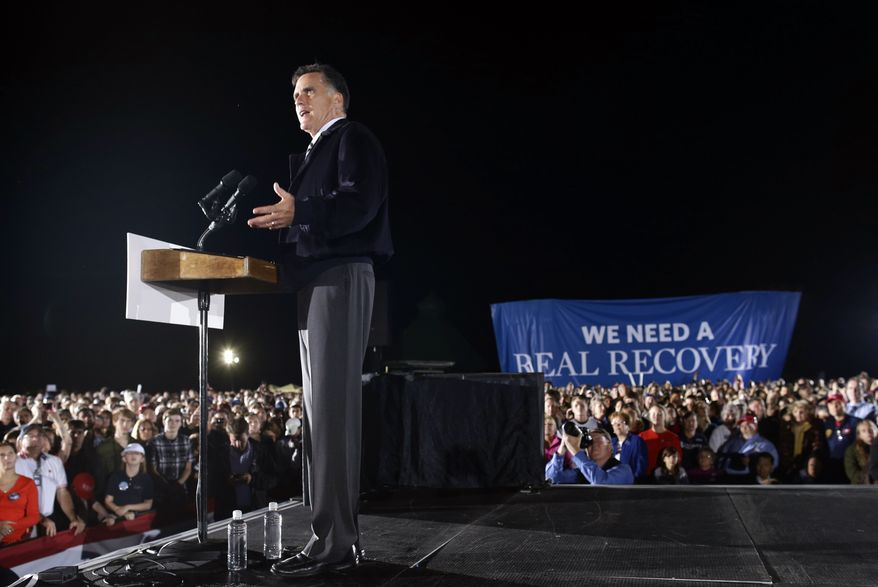 FILE - In this Oct. 17, 2012 file photo, Republican presidential candidate and former Massachusetts Gov. Mitt Romney campaigns at Ida Lee Park in Leesburg, Va. (AP Photo/Charles Dharapak)