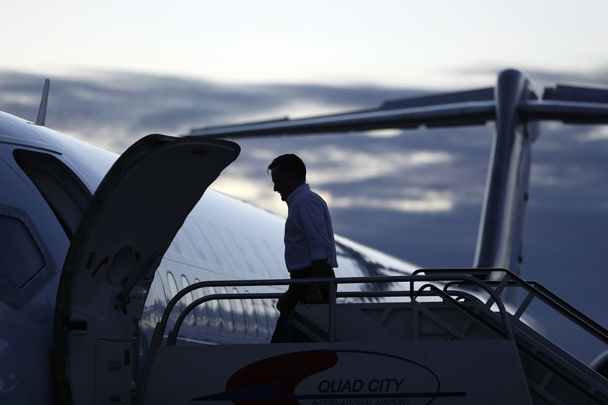 Republican presidential candidate Mitt Romney boards his campaign plane in Moline, Ill., as he heads to Dayton, Ohio, on Monday, Oct. 29, 2012. (AP Photo/Charles Dharapak)