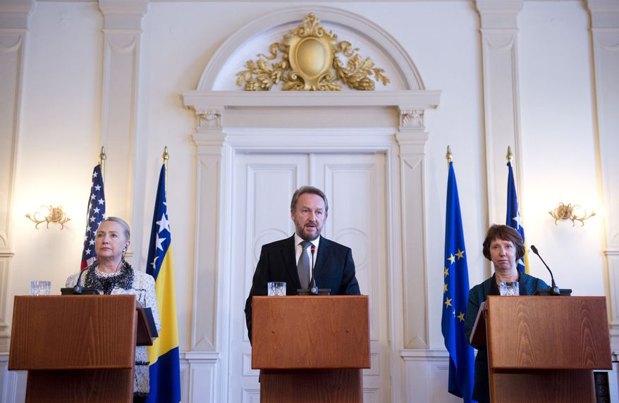 Bakir Izetbegovic (center), chairman of the Bosnia and Herzegovina tri-presidency, speaks alongside U.S. Secretary of State Hillary Rodham Clinton (left) and Catherine Ashton, high representative for European Union foreign policy, during a press conference at the Presidency in Sarajevo, Bosnia-Herzegovina, on Tuesday, Oct. 30, 2012. (AP Photo/Saul Loeb, Pool)