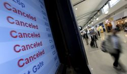 A Delta Air Lines departures monitor shows flights canceled because of Hurricane Sandy on Monday, Oct. 29, 2012, at Detroit Metropolitan Wayne County Airport outside Detroit. (AP Photo/Charlie Riedel)